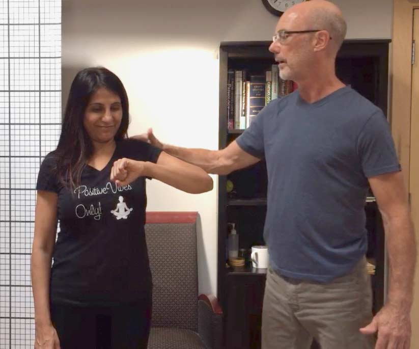 Assessing range of motion with a frozen shoulder client